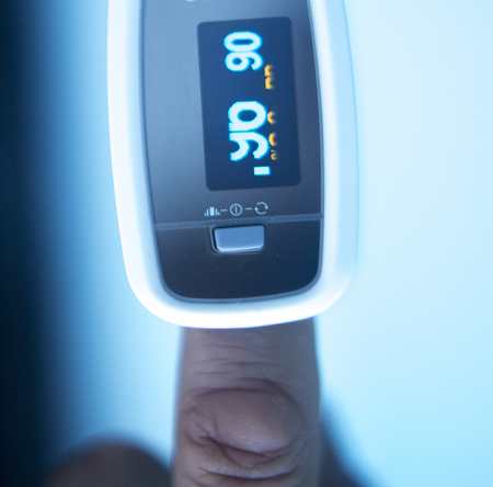 resting heart rate: Blood pressure finger resting pulse monitor used to take heart rate and irregular beats with cardiogram.