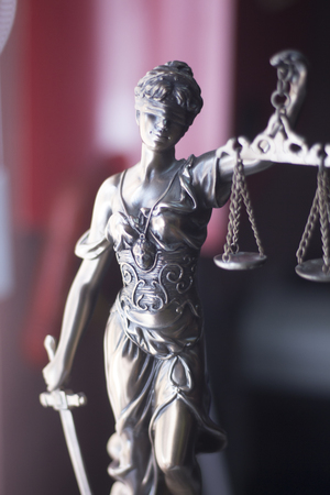 Law offices of lawyers legal statue Greek blind goddess Themis bronze metal statuette figurine with scales of justice. Stock Photo