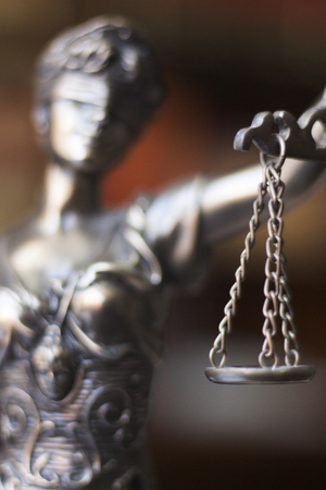 judicature: Law offices of lawyers legal statue Greek blind goddess Themis bronze metal statuette figurine with scales of justice. Stock Photo