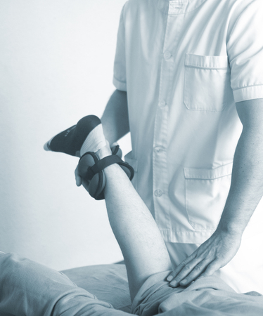 Physical therapy manual physiotherapy treatment by physiotherapist on patient for knee inury rehabilitation.