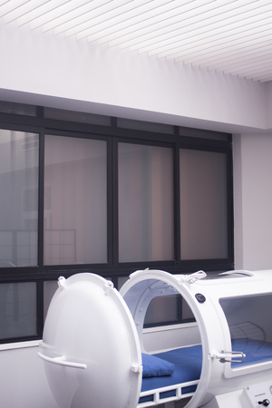HBOT hyperbaric oxygen therapy tank chamber in hospital clinic to treat patients for diseases and medical conditions.
