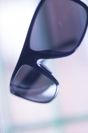 tinted glasses: Mens fashion sunglasses. Dark tinted UV protection glasses used to protect the eyes from the sun.