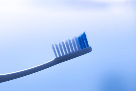 Dental toothbrush to clean teeth isolated in bathroom closeup.