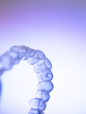 bracket: Invisible teeth retainers orthodontic brackets. Plastic modern straighterners to correct tooth alignment.
