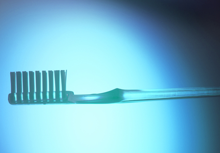 Dental toothbrush closeup isolated on abstract background