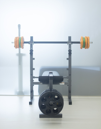 Barbell weights training bench in physiotherapy medical fitness center gym.