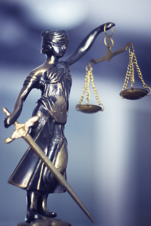 punishing: Legal law firm bronze statue of the goddess themis with scales of justice in attorneys office.
