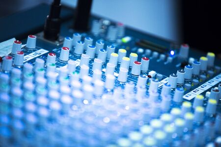 Deejay live electronic dj music mixing desk with buttons and controls in Ibiza house disco party.