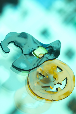 month: Halloween chidrens party toy pumpkin ghost levitating flying in the air. Stock Photo