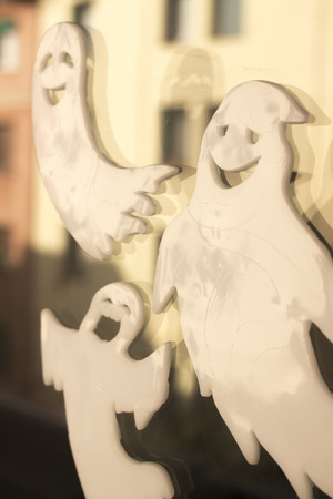 Halloween chidrens party toy ghost levitating flying in the air.