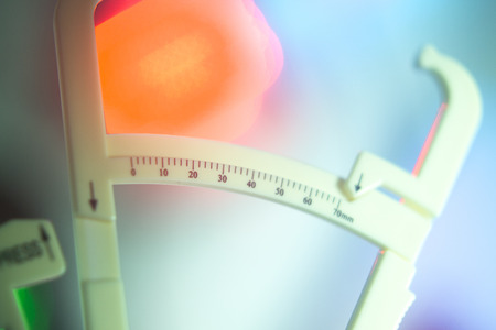 Weight loss diet fat calipers to measure bodyfat levels for healthy regime of fitness.