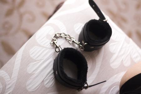 Sensual adult bdsm sadomasochis hand cuffs