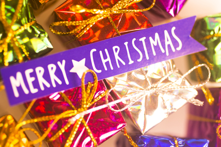 Xmas party celebration presents gift wrapped miniatures Merry Chritmas tag.