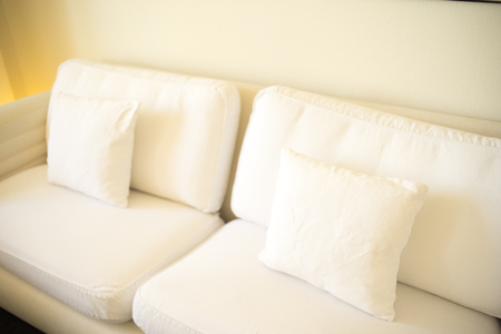 Luxury modern style hotel suite bedroom with bed, sheets, pillows clean and ready for guests.