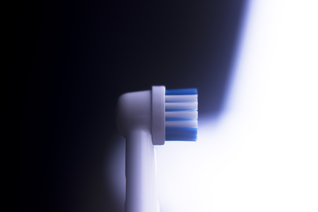 Electric modern tooth brush closeup on plain abstract background. Stock Photo