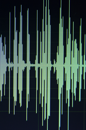 Audio sound wave studio editing computer program screen showings sounds on screen from vocal recording of voiceover. Stock Photo