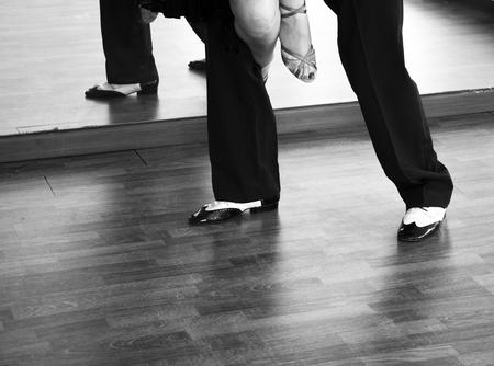 Ballroom dance salsa dancer instructors man and woman couple dancing in shcool rehearsal room Stock Photo