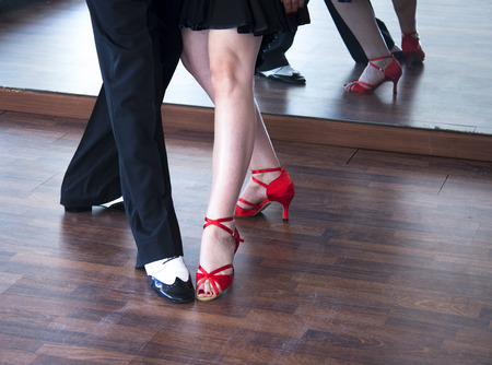 Ballroom dance salsa dancer instructors man and woman couple dancing in shcool rehearsal room Stock Photo