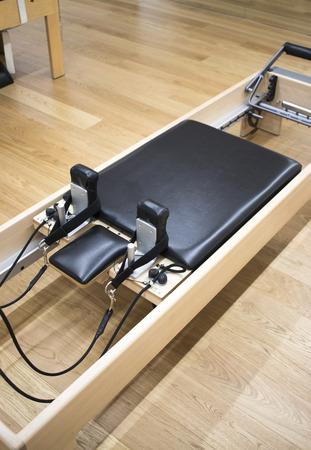 Pilates machine fitness studio gym room with training machines