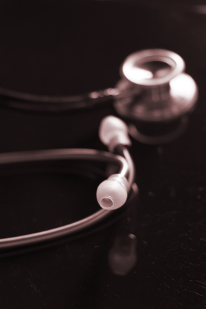 Doctors medical stethoscope used by doctor o nurse to listen to patient heartbeat in hospital. Stock Photo