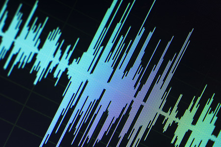 Audio sound wave studio editing computer program screen showings sounds on screen from vocal recording of voiceover. 스톡 콘텐츠