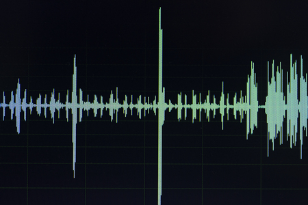 Audio sound wave studio editing computer program screen showings sounds on screen from vocal recording of voiceover. Stock fotó