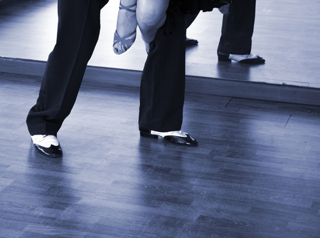 Ballroom dance salsa dancer instructors man and woman couple dancing in school rehearsal room