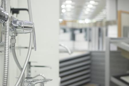 Bathroom showroom display of new sink chrome tap design option for home building improvement works.