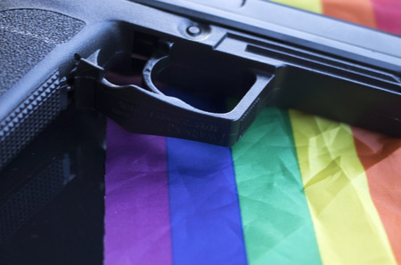 Automatic pistol handgun with LGBT pride rights flag colors.