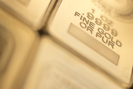 Gold bullion 999.9 purity solid one ounce ingot precious metal bars.
