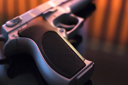 Pistol automatic handgun weapon on table