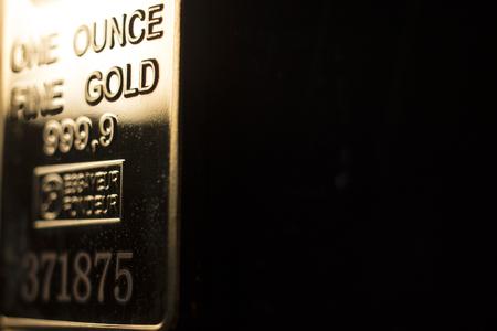 Fine solid gold 999.9 one ounce bullion ingot precious metals bar Stock Photo