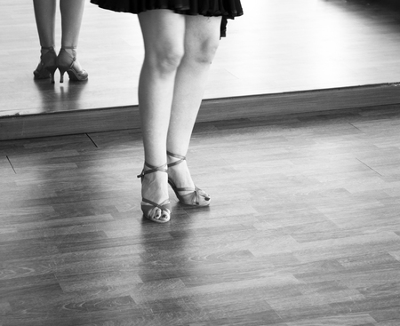 Female ballroom dance salsa dancer instructor woman dancing in shcool rehearsal room