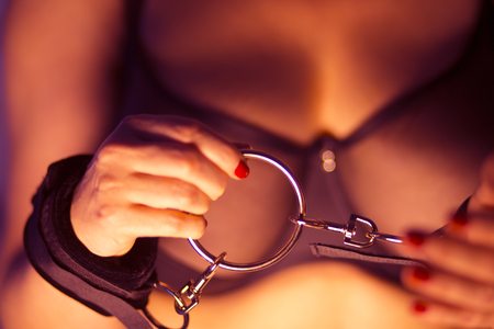 Bondage kinky adult sex game adult erotic lady model in sexy lingerie underwear bra with handcuffs toy.