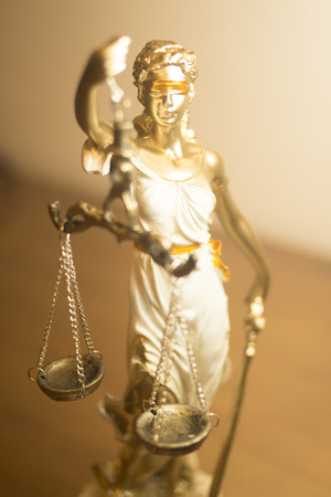 Lawyers legal blind justice bronze statue Themis and scales in attorneys law firm offices. 스톡 콘텐츠 - 122896896
