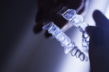Clear dental teeth retainer brackets to straighten and align each tooth in modern dentistry technology.