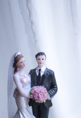 Cake topper bride and groom wedding couple of holding romantic marriage embrace of  love.