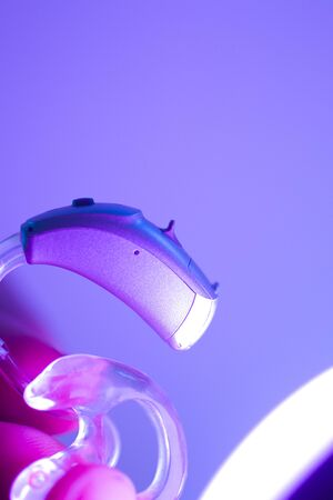 Modern digital hearing aid for deafness and deaf people.