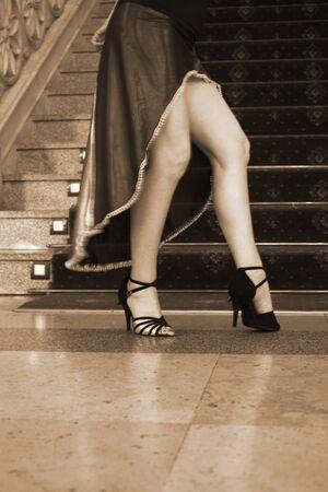 Ballroom latin salsa hot sexy female dancer dancing in modern sport dance showwith slim long legs,