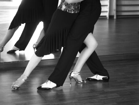 Ballroom dance salsa dancer instructors man and woman couple dancing in shcool rehearsal room 写真素材