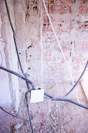 Building renovation works in appartment work by builders to renovate walls. Foto de archivo
