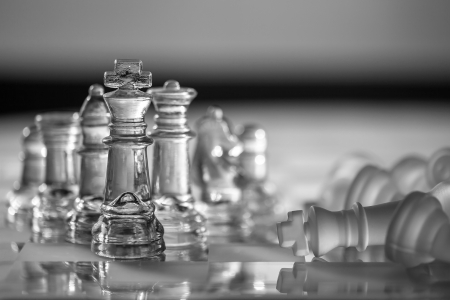 Chess Pieces - business concept  competition, win, survive, strategy, defeat, checkmate  photo