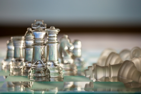 Business Concept - chess pieces - team, company, strategy, win, checkmate, success