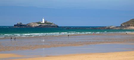 Lighthouse panorama - sea, waves, pretty, bathers, tourists Stock Photo - 16436142
