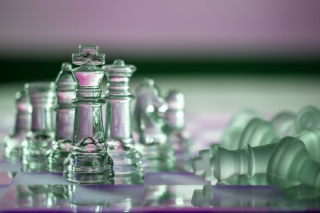 Chess pieces - business concept - in a series: compete, strategy, intelligence, power,  leadership, team, player, win, survive.