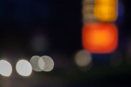 Town or City Lights at Night, neon / car lights blurred out of focus, background texture - space for copy / text. Stock Photo - 16903181
