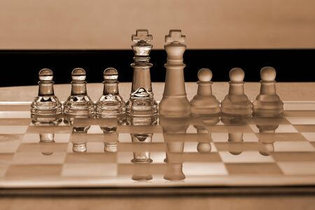 company merger: Chess Pieces  Set: King and pawns - as business concept series: strategy, competition, merger, leadership, corporation, company.