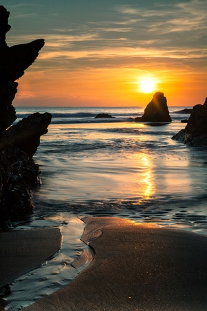 Sunset over Beach and Sea - with beautiful reflections - taken in Cornwall, UK Stock Photo