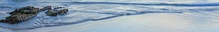Ocean Tide and Waves: A very long panoramic shot of waves and rocks at the tide line - space for text / copy or header. Stock Photo - 17364775
