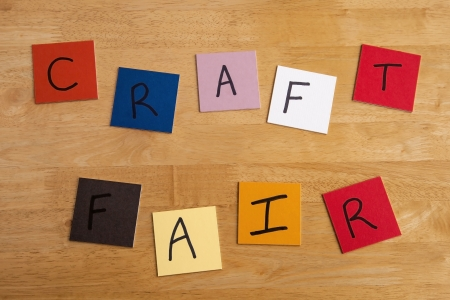 fairs: Craft Fair in  letters  words on bright and colorful square color tiles for arts and crafts fairs.